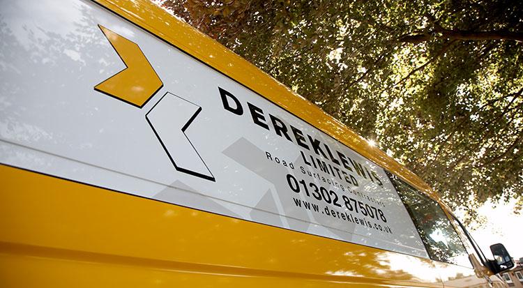Derek Lewis Logo on van by Redesign